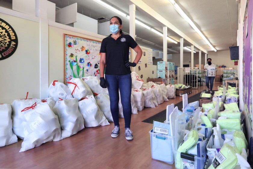 Volunteers, including Nancy Maldonado, CEO of the Chicano Federation, distributed cleaning supplies and sanitation kits to independent child care providers in San Diego on May 2, at the Barrio Logan Child Development Center.