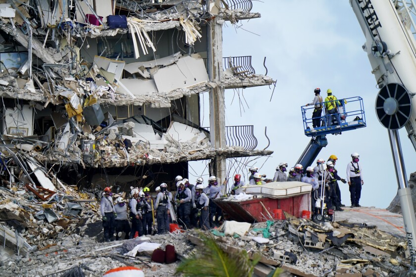 Workers search the rubble at the Champlain Towers South Condo