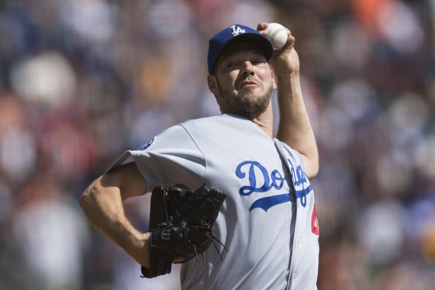 Los Angeles Dodgers starting pitcher Rich Hill throws against the San Francisco Giants in the second inning of a baseball game in San Francisco, Sunday, Sept. 30, 2018.