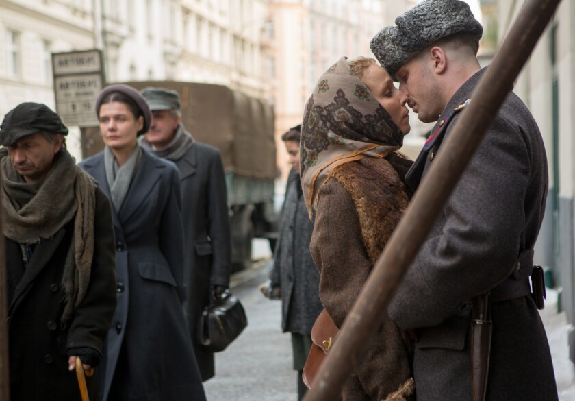 "Leo and Raisa (Tom Hardy and Noomi Rapace) try a little tenderness in 1953 Soviet Union in ""Child 44."""