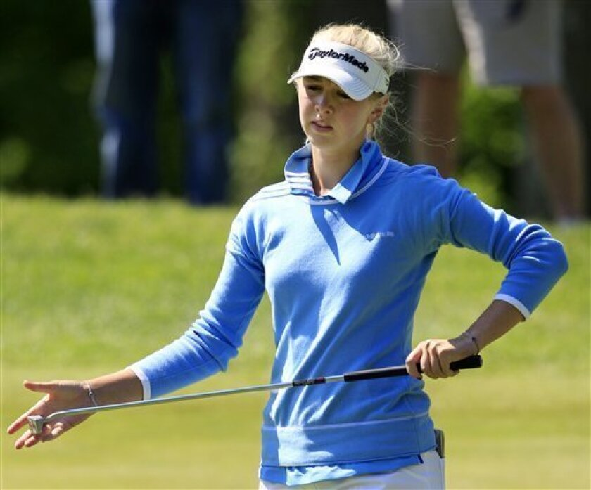 Jessica Korda, of the Czech republic, reacts to her putt on the second hole during a first round match against Hee Kyung Seo of South Korea, in the LPGA Sybase Match Play Championship golf competition at Hamilton Farm Golf Club in Gladstone, N.J., Thursday, May 17, 2012. (AP Photo/Mel Evans)