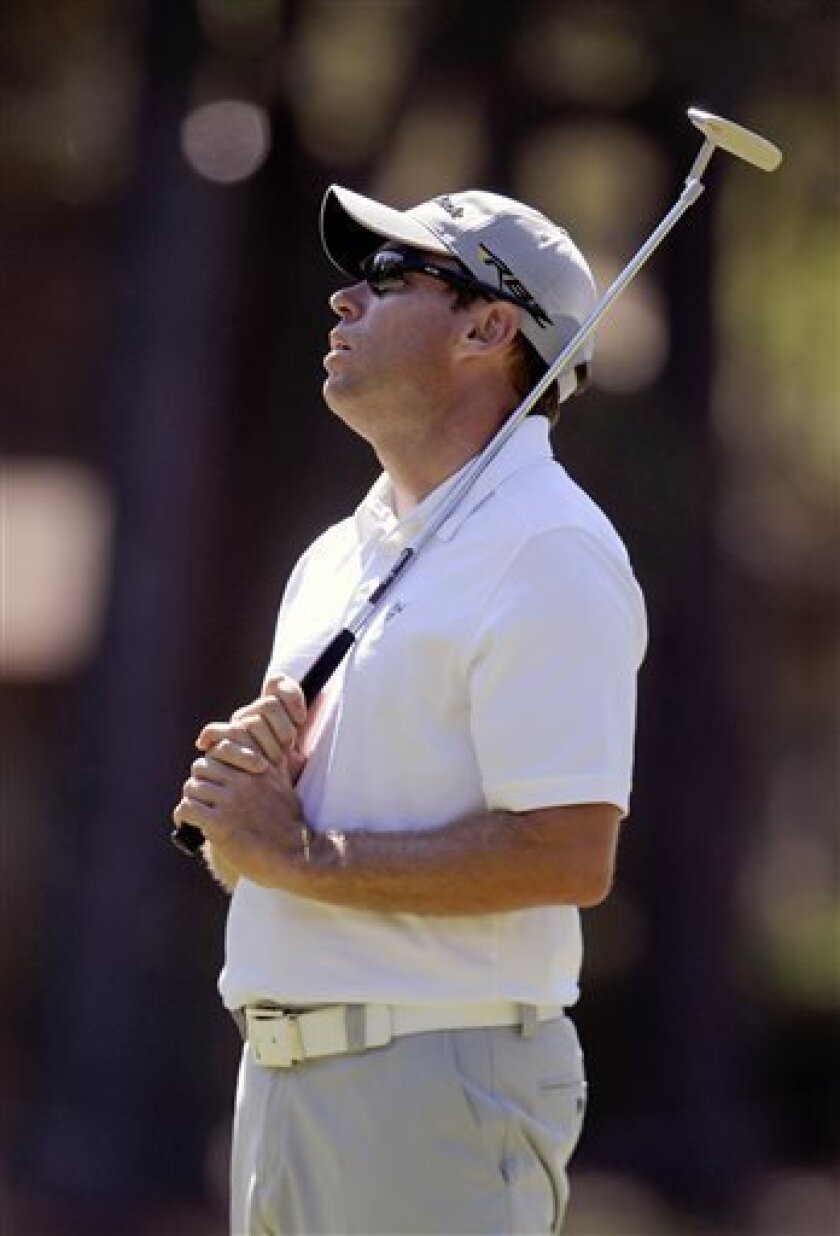 CORRECTS YEAR - Brian Davis, of England, reacts to a missed birdie putt on the eighth green during the first round of the RBC Heritage golf tournament in Hilton Head Island, S.C., Thursday, April 18, 2013. (AP Photo/Stephen Morton)