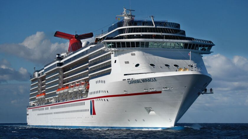The Carnival Miracle approaches Freeport in the Bahamas. Built in Finland for $375 million, the ship