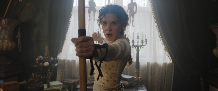 "This image released by Netflix shows Millie Bobby Brown in a scene from ""Enola Holmes."" (Netflix via AP)"