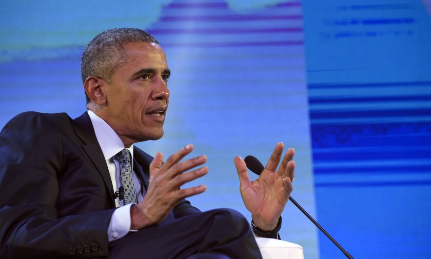 President Obama speaks to business leaders at an international summit in Manila on Wednesday.