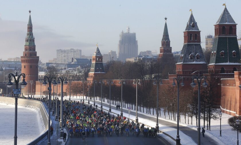 Cyclists pass by the Kremlin as they take part in a winter bike parade in Moscow on Jan. 8, 2017.