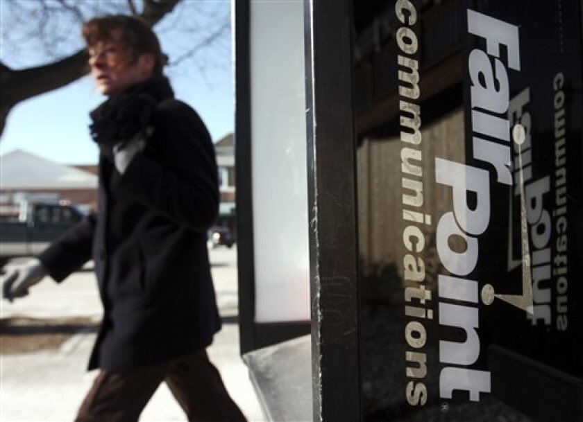 FILE - In this Feb. 1, 2010 file photo, a pedestrian passes a FairPoint Communications pay phone in Brunswick, Maine. The telecommunications company FairPoint Communications Inc.'s debt would be cut by nearly two-thirds under its bankruptcy reorganization plan filed Monday, Feb. 8, 2010. (AP Photo/Pat Wellenbach, File)