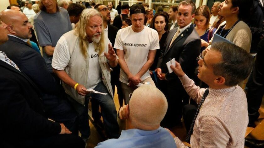 Venice residents opposed to a new homeless shelter on the site of a vacant Metropolitan Transportation Authority lot speak to L.A. Mayor Eric Garcetti at a town hall event on Oct. 17.