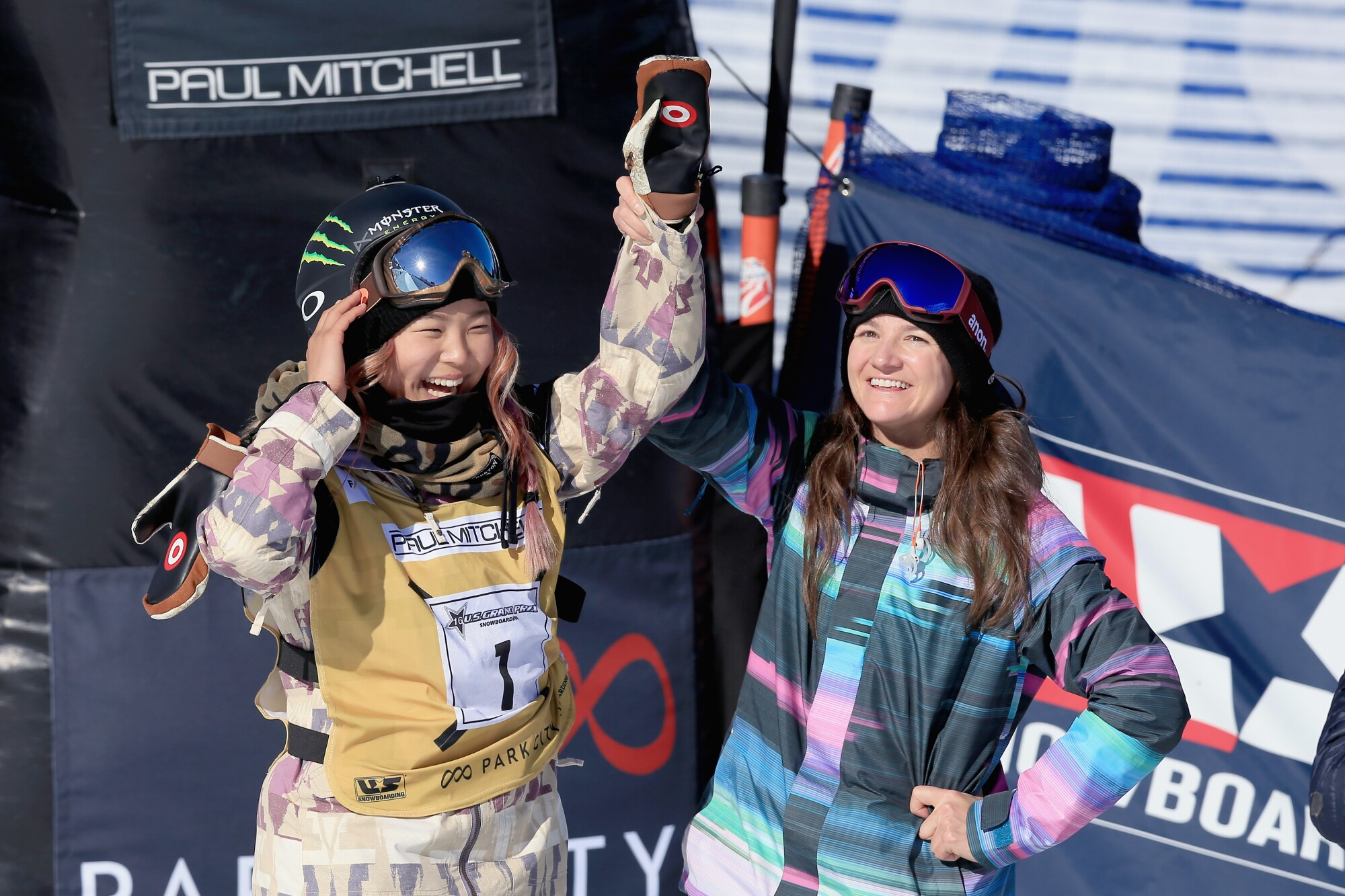 Chloe Kim, left, celebrates a first-place finish with Kelly Clark in the ladies' FIS Snowboard World Cup at the 2016 U.S Snowboarding Park City Grand Prix in Park City, Utah.