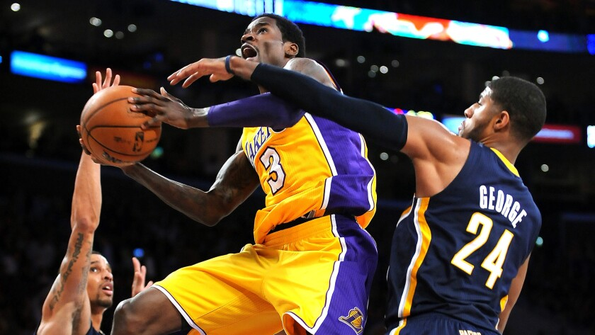 While with the Lakers on a 10-day contract, guard Manny Harris puts up a shot in January 2014 during a loss to the Indiana Pacers.