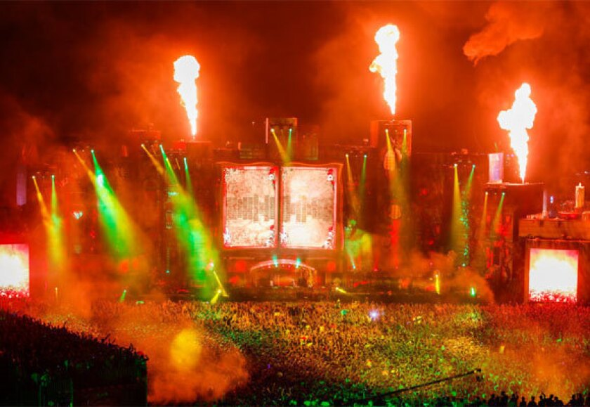 Pyrotechnics and laser show elements dazzle the crowd during the set by DJ producer Avicii at Tomorrowland in Boom, Belgium.
