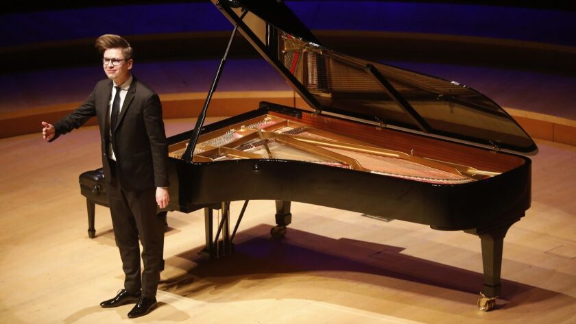 LOS ANGELES, CA - APRIL 21, 2019 - - Vikingur Olafsson acknowledges applause from the audience after