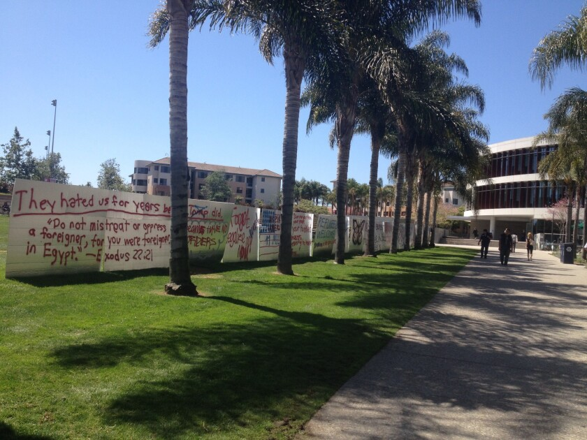 A wall of Styrofoam and foil at Loyola Marymount University emblazoned with sayings in support of immigrant students was defaced.