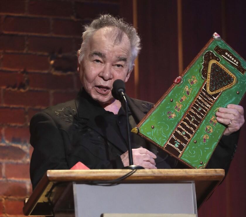 John Prine accepts an award in Nasvhille, Tenn., in 2018.