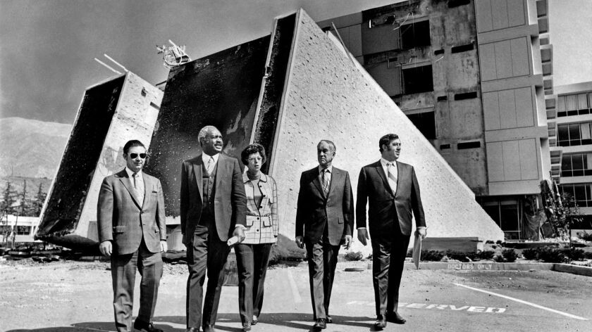 MAR. 4, 1971 - Touring the quake destruction at Olive View Hospital are, from left, health commissio