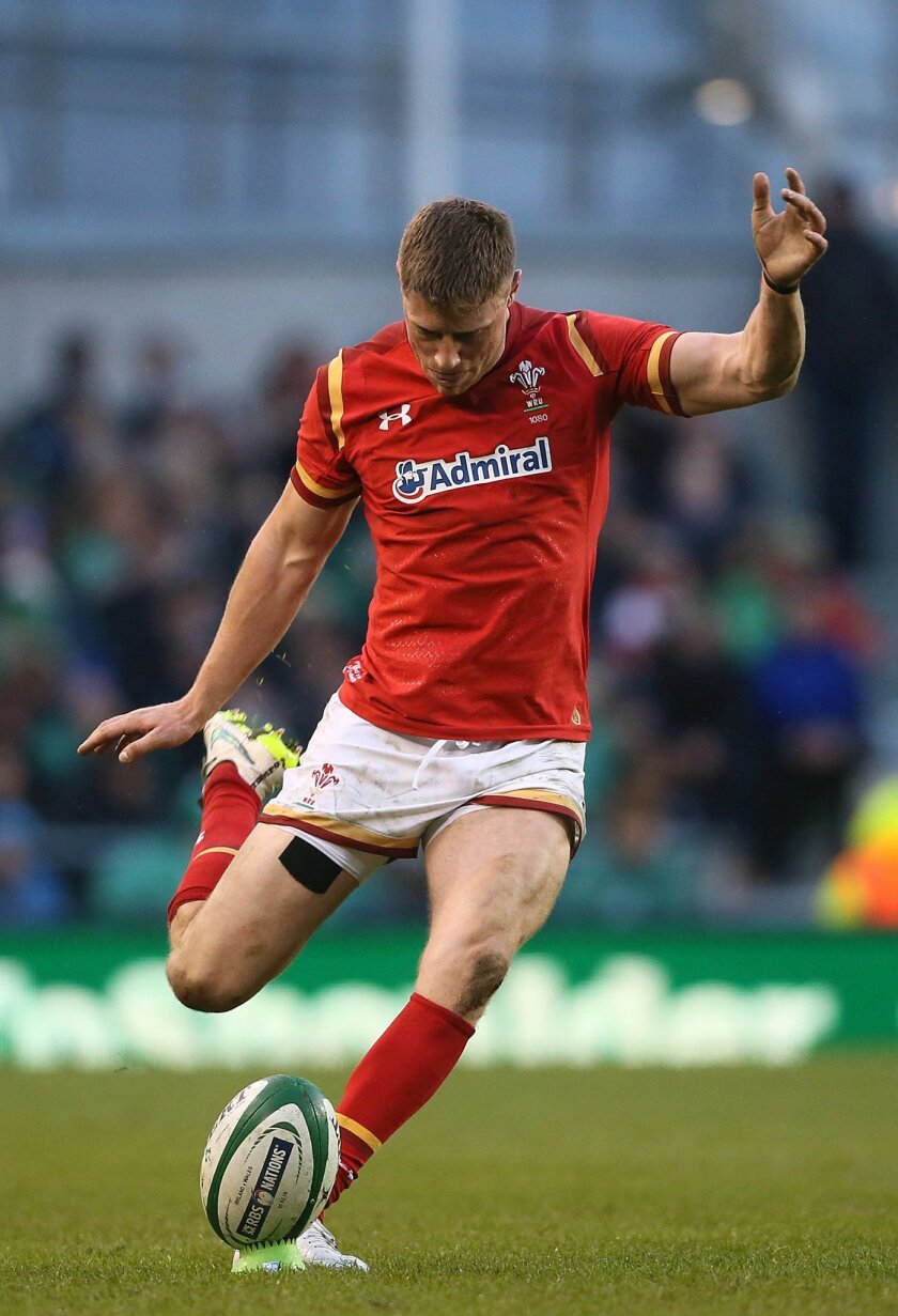 Wales' Rhys Priestland takes a penalty kick during the 2016 Six Nations rugby match at the Aviva Stadium in Dublin, Ireland, Sunday Feb. 7, 2016.  (Niall Carson / PA via AP) UNITED KINGDOM OUT - NO SALES - NO ARCHIVES