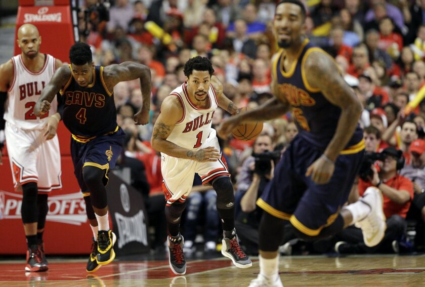 Chicago Bulls guard Derrick Rose (1) brings the ball up court against the Cleveland Cavaliers during the second half of Game 6 in a second-round NBA basketball playoff series in Chicago on Thursday, May 14, 2015. (AP Photo/Nam Y. Huh)