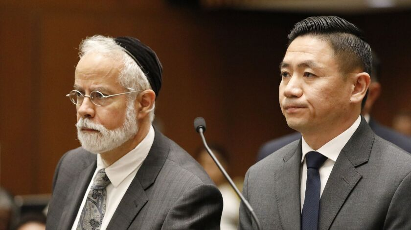 Los Angeles County Sheriff's Deputy Luke Liu, right, appears with his attorney, Michael D. Schwartz, in a downtown courthouse in 2018. Liu was ordered to stand trial for voluntary manslaughter.