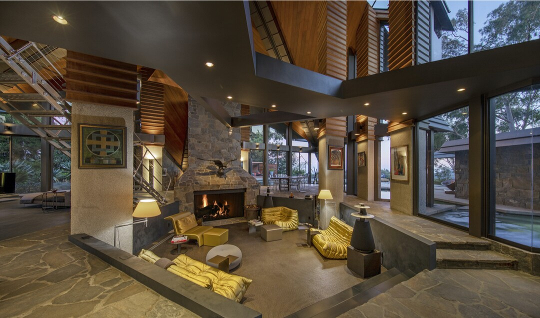 Built in the '70s, the triangle-filled home centers on a dramatic conversation pit under 40-foot ceilings.