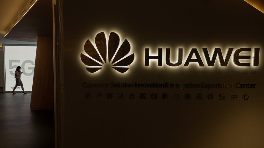 """A view of the Huawei logo during the event """"5G is On"""" in Madrid on Wednesday."""