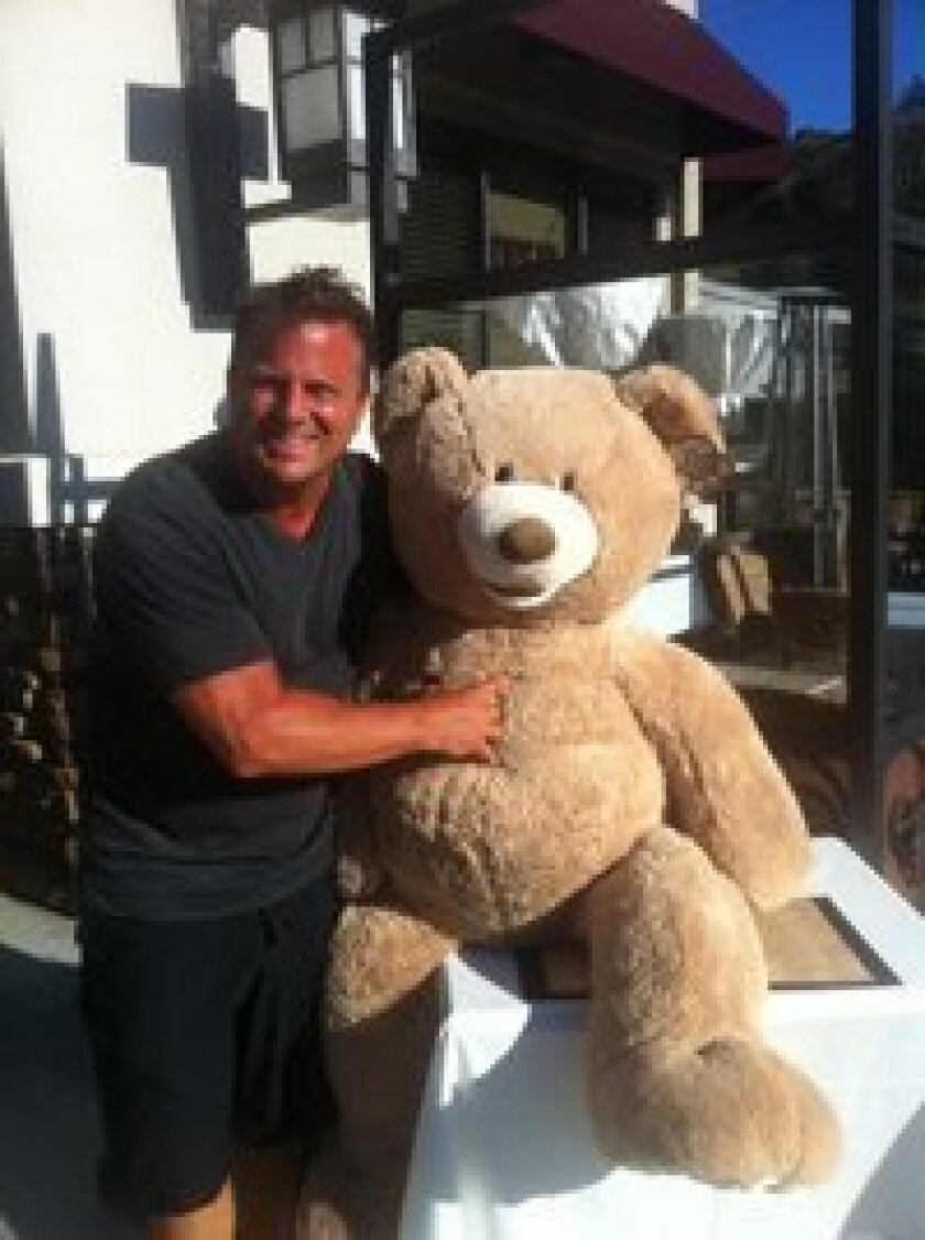 (Above) David Bono, owner of Taste of Italy, with one of the bears that will be a raffle prize.