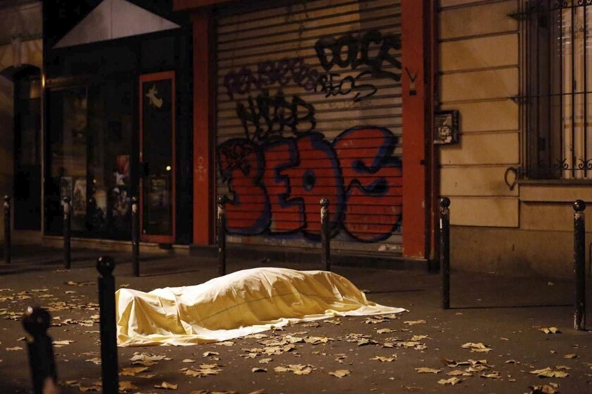 Body of a victim is covered in a Paris street