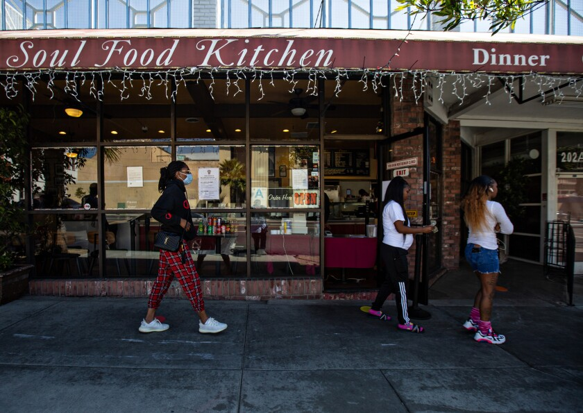 Customers outside Dulan's Soul Food Kitchen in Inglewood