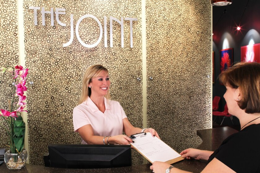 The Joint offers chiropractic care using a membership model. The location pictured is in Scottsdale, Ariz.; several are being developed in San Diego.
