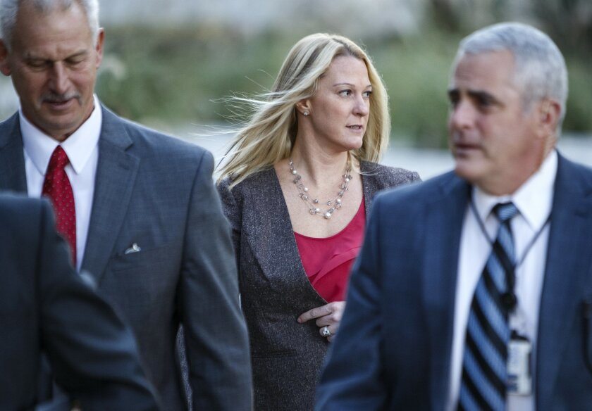Hunnelstown police Officer Lisa Mearkle arrives for her murder trial at the Dauphin County Courthouse in Harrisburg, Pa. on Wednesday, Nov. 4, 2015. Mearkle is charged with third-degree murder for shooting David Kassick after he fled from a Feb. 2 traffic stop in Hummelstown, a Harrisburg suburb. T