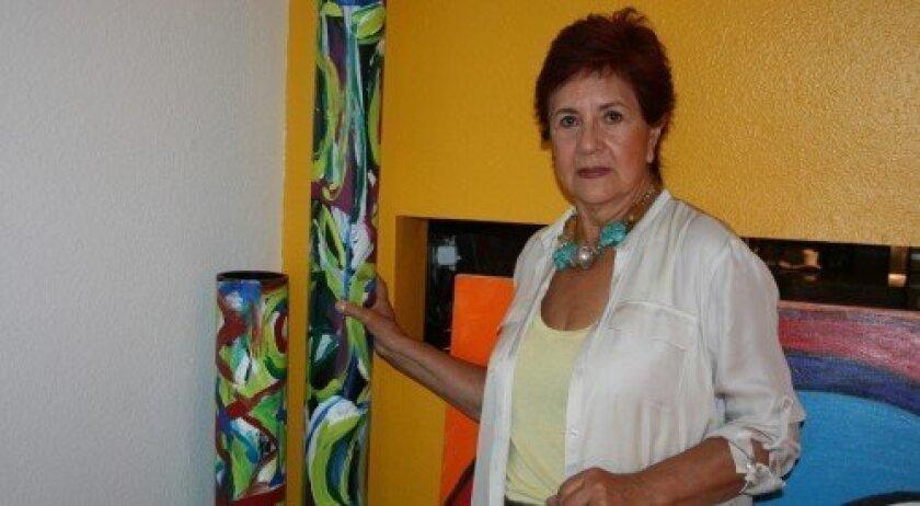 Alix Gonzalez Dumka and her artwork.  Photos/Kristina Houck