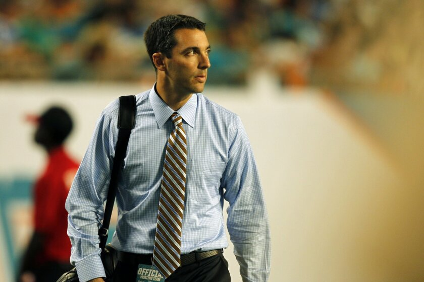 Chargers Tom Telesco looks on against the Dolphins.