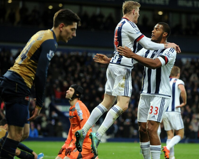 West Brom's James McClean, centre, celebrates with teammate Solomon Rondon, right, after scoring against Arsenal during the English Premier League soccer match between West Bromwich Albion and Arsenal at the Hawthorns, West Bromwich, England, Saturday, Nov. 21, 2015. (AP Photo/Rui Vieira)