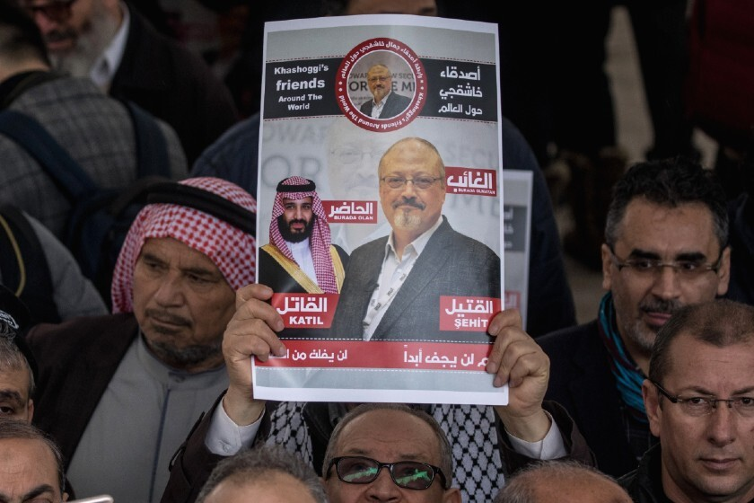 A poster featuring two images of Jamal Khashoggi is displayed during a prayer service in Istanbul in 2018.