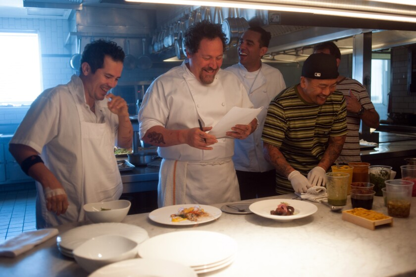 "Behind the scenes of the movie ""Chef"" written by, directed by, and starring Jon Favreau, center. Favreau and Roy Choi will host an El Jefe pop-up dinner at Animal restaurant Wednesday. Pictured from left, John Leguizamo, Jon Favreau, Bobby Cannavale, and chef Roy Choi."