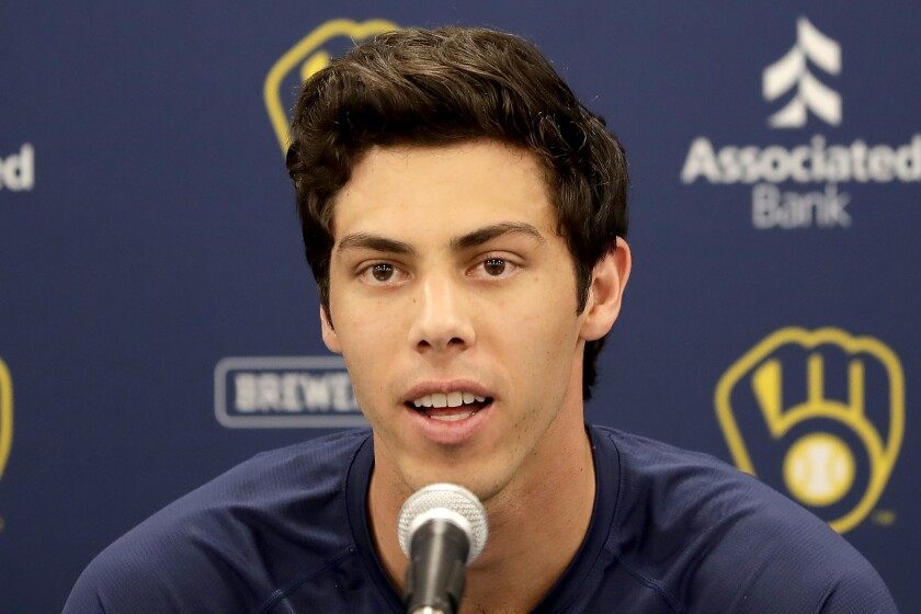 FILE - In this March 6, 2020, file photo, Milwaukee Brewers' Christian Yelich speaks after the Brewers announced his multi-year contract extension at the team's spring training facility in Phoenix. Yelich acknowledges he benefited from fortunate timing in how he handled his contract negotiations. The Brewers held the March 6 news conference to announce that the 2018 NL MVP had agreed to a nine-year, $215 million contract. Spring training was halted due less than a week later due to the coronavirus. (AP Photo/Matt York, File)