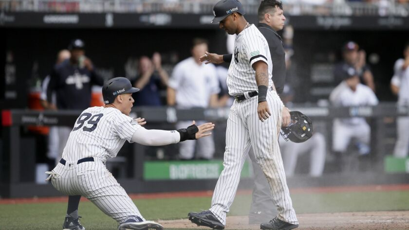 New York Yankees' Aaron Judge, left, and Aaron Hicks celebrate after scoring on a single by Gary San