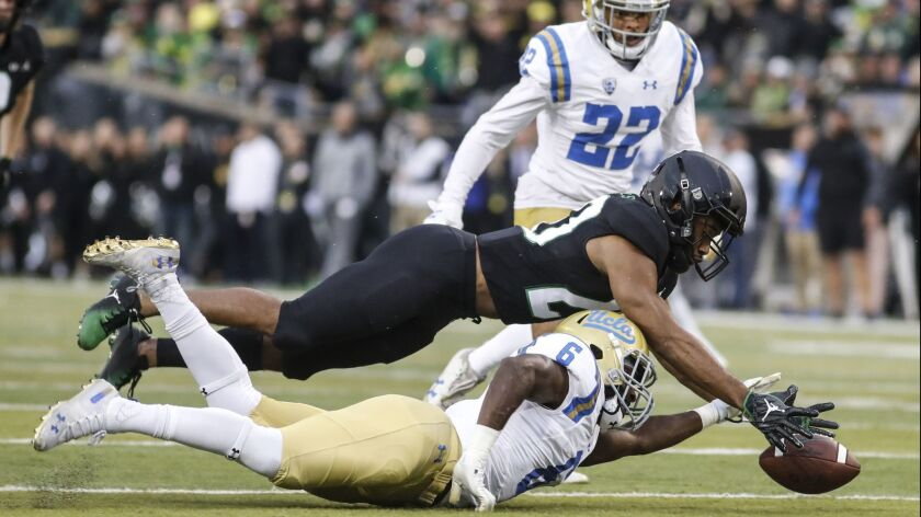 Oregon running back Tony Brooks-James (20), recovers a fumble on a punt return from UCLA defensive b