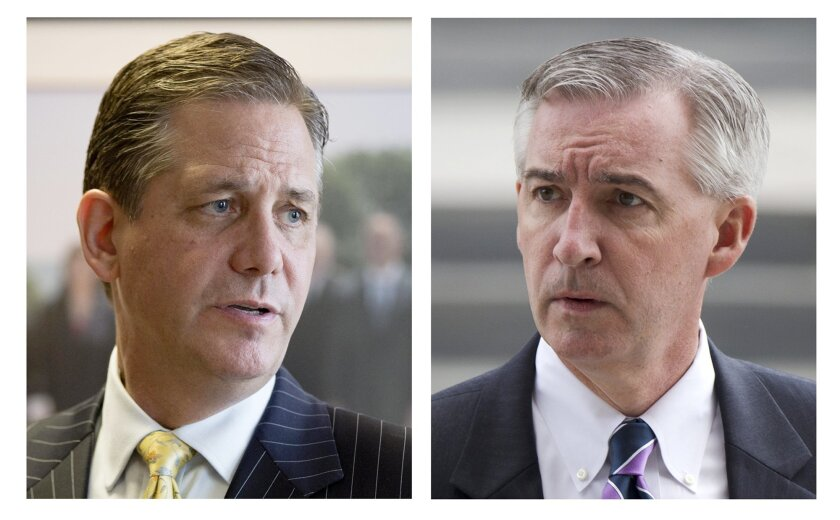 FILE - This 2015 combination of file photos shows, Montgomery County officials, commissioner Bruce L. Castor Jr., left, and first assistant district attorney, Kevin Steele, in Norristown, Pa. Castor, a Republican and Steele, a Democrat, are running for Montgomery County District Attorney in the Tue