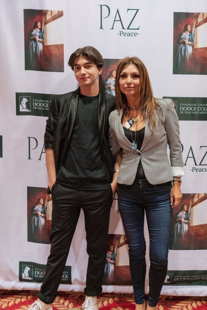 """Elena Sahagun with her son Colin at the premiere of """"Paz."""""""