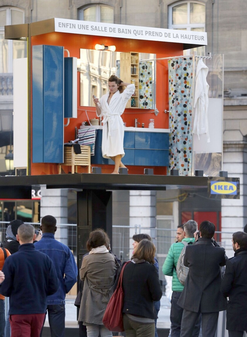 An actress is the star of a live Ikea billboard in front of a Paris train station.