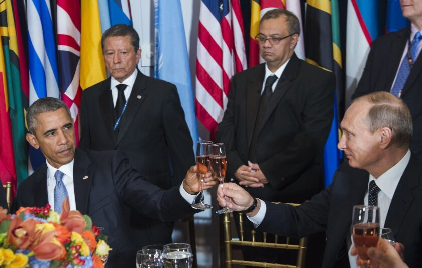 President Obama and Vladimir Putin share a toast at a U.N. luncheon in New York on Sept. 28.