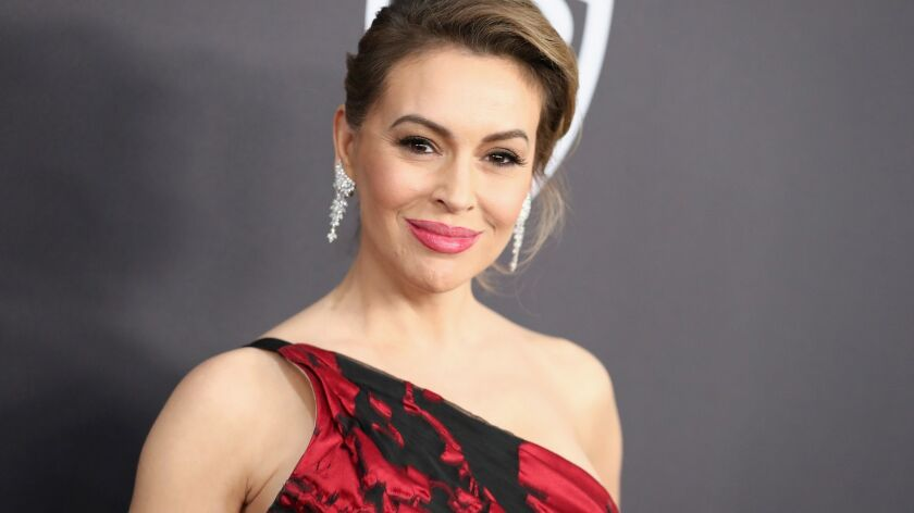 Actress Alyssa Milano's tweets about Make America Great Again hats have sparked an angry response.