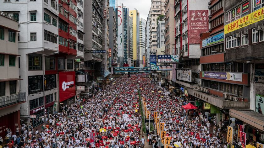 Protesters march in Hong Kong against a controversial extradition bill that would allow suspected criminals to be sent to mainland China for trial.