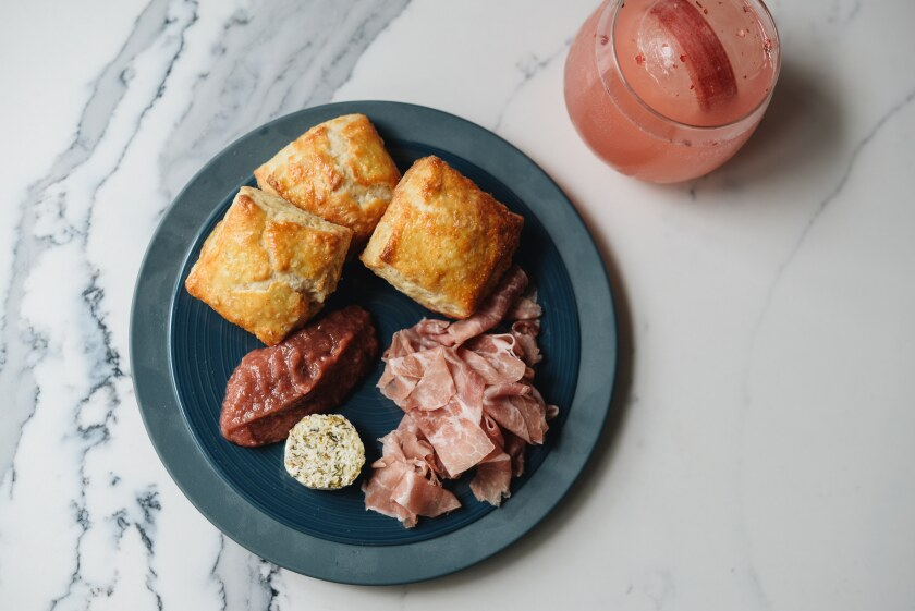 You & Yours' ham and biscuit plate, with seasonal butter and jam, paired with Rhubarbie's Dream House cocktail is a dream.