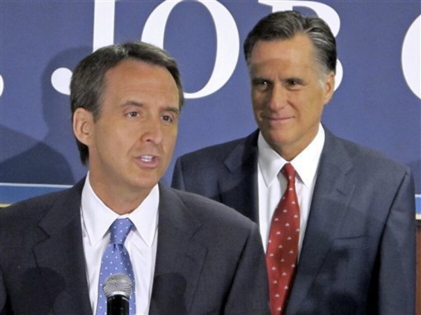 Former Minnesota Gov. Tim Pawlenty, left, discusses his endorsement of Republican presidential candidate, former Massachusetts Gov. Mitt Romney, right, during a news conference in North Charleston, S.C., Monday, Sept. 12, 2011. (AP Photo/Bruce Smith)