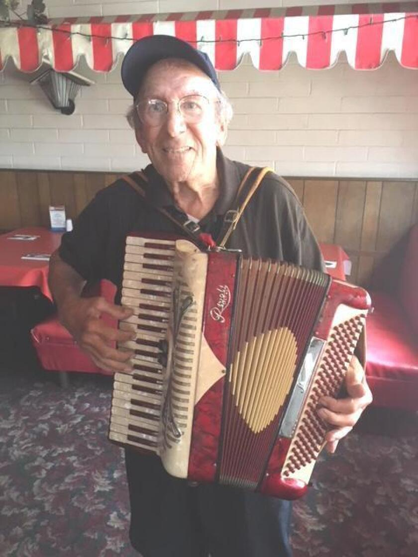 Owner Johnny Pernicano on accordion entertains guests at Pernicano's Family Restaurant in Pacific Beach.