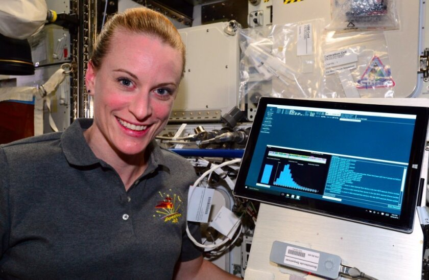 Astronaut Kate Rubins with sequencing data over the weekend aboard the International Space Station.