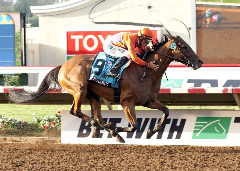 Beholder and jockey Gary Stevens win the Pacific Classic at Del Mar on Saturday.