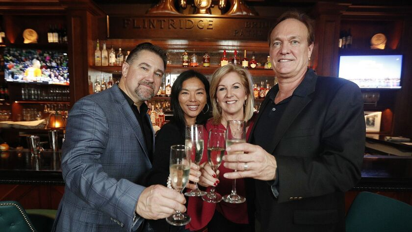 Co-owners Rick and Lisa Anderson, left, Cater Lee Yost and David Yost inside the Proper, the restaurant they purchased earlier this year and will soon open to the public. The Flintridge Proper, a local hangout spot known for its handcrafted cocktails, closed in April.