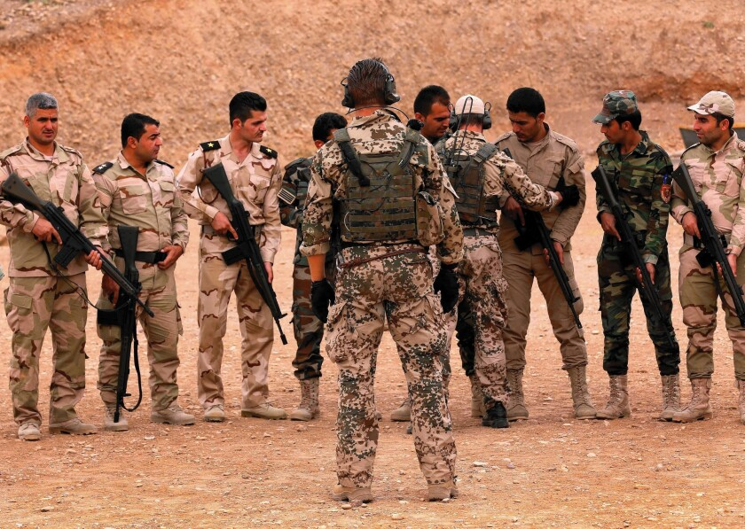 German military trainers instruct Kurdish peshmerga fighters in Irbil, Iraq, on Oct. 2. Kurdish commanders say the training by the U.S. and its allies is moving too slowly.